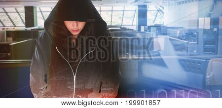 Female hacker in black hoodie against composite image of blue technology design with binary code