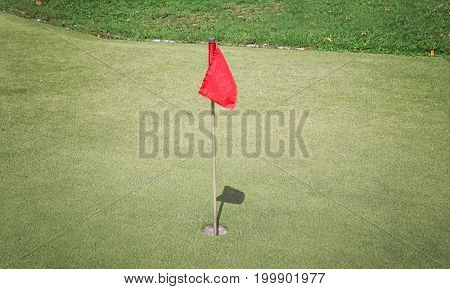 Flag and hole on golf course