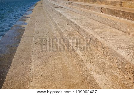 Abstract Concrete Stairs To Building Background. Cement Dirty Grunge Staircase With Seaside.