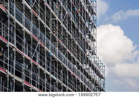 scaffolding at construction site of a glass office building