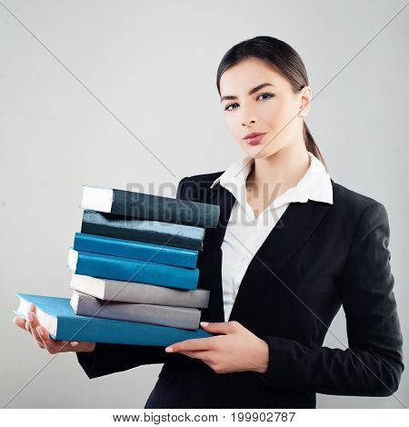 Young Friendly Girl Student with Book on Background with Copyspace