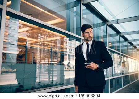 Handsome Businessman Walking With Mobile Phone