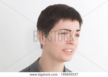 A strong image of a very upset and emotional woman crying and screaming on the white background