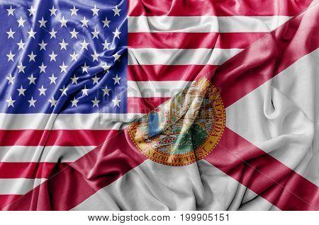Ruffled waving United States of America and Florida flag