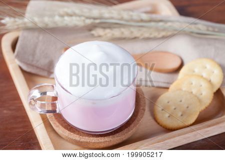 Close Up Hot Pink Milk With Biscuits On Wooden Plate On Wooden Table For Breakfast.