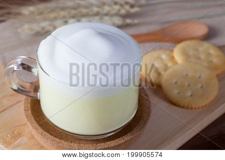 Close Up Hot Green Milk With Biscuits On Wooden Plate On Wooden Table For Breakfast.