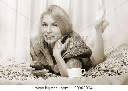 Woman Lying At The Bed And Smiling.