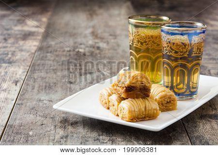 Typical turkish dessert baklava on wooden table
