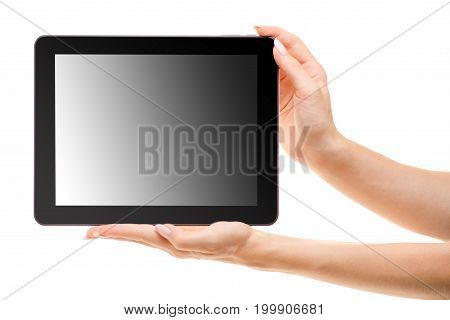 Tablet in female hands isolated on white background isolation