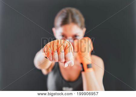 Power Female Punching With Boxing Bandage