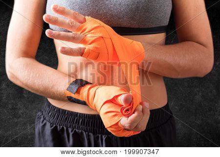 Female Hands Wearing Boxing Bandages