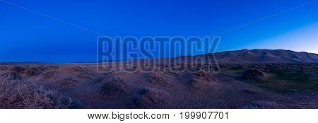 beautiful night landscape in desert against the sky