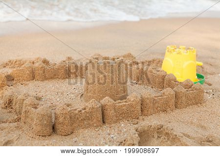 Summer Holiday With Sandcastle On The Beach