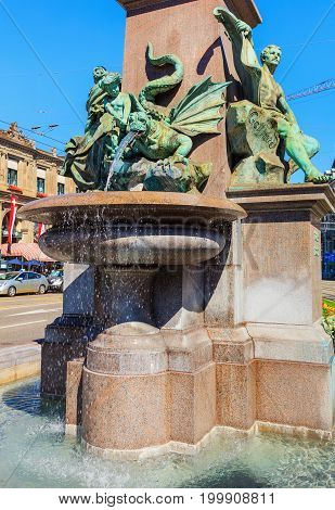 Zurich, Switzerland - 20 July, 2016: the fountain at the basement of the monument to Alfred Escher on Bahnhofplatz square in the city of Zurich. Alfred Escher was a renowned Zurich politician, businessman and railway pioneer.