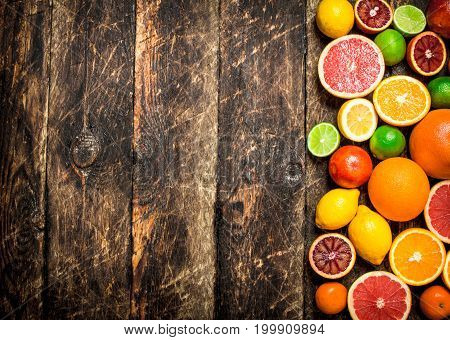 Citrus Background. Fresh Citrus Fruits - Lemons, Oranges, Limes, Grapefruits.