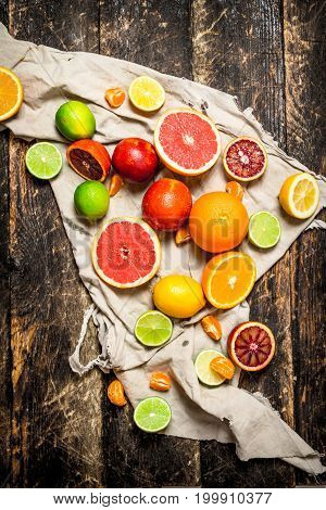 Citrus Background. Citrus Fruit On The Old Fabric.