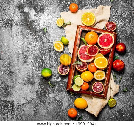 Citrus Background. Citrus Fruits In The Old Tray.