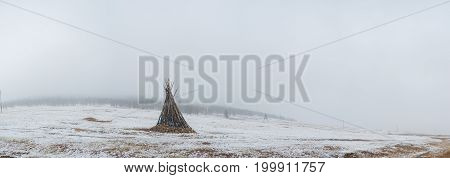 ceremonial bonfire in snowy mongolian prairie at winter day