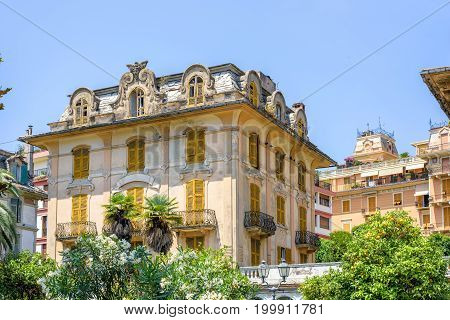 Daylight view to old abandoned hotel or apartments in Rapallo city, Italy
