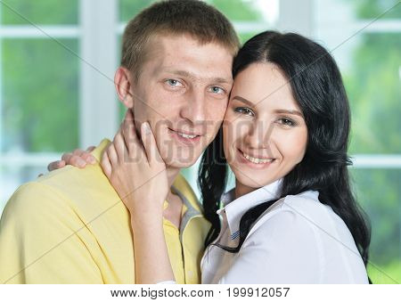 Portrait of a cheerful young couple hugging