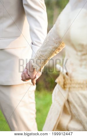 Holding Hands Of Lovers On Wedding Day In Thailand