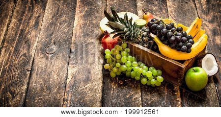 Various Ripe Fruits In A Wooden Box.