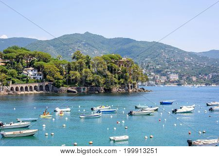 Daylight view to boats on water and city of Rapallo, Italy.
