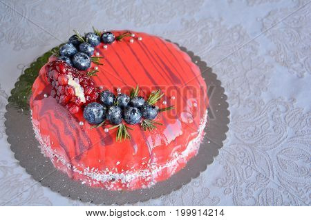 Homemade orange mousse cake decorated with berry on white background