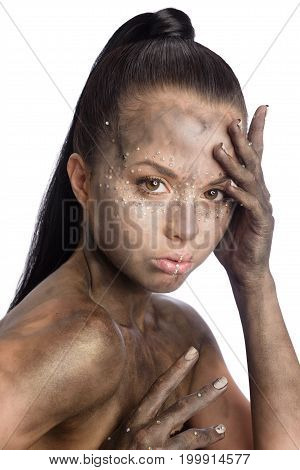 Brunette beautiful woman with crystals on face. Fashion creative black make-up on neck and hands with Swarovski. Dirty skin