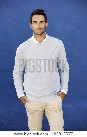 Blue sweater guy smiling to camera portrait