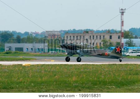 Aircraft of the second world Ilyushin Il-2 Russia, Moscow, Zhukovsky Airport - July 23, 2017: Reconstructed World War II attack aircraft Ilyushin Il-2 In flight against the blue sky background.