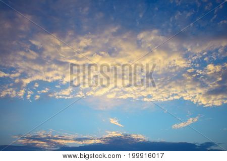 cirrus clouds against the blue sky background.