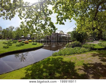 KEUKENHOF HOLLAND - MAY 14 2017: Pond and Pavilion of the King of the Netherlands Willem-Alexander in the Royal Keukenhof Park