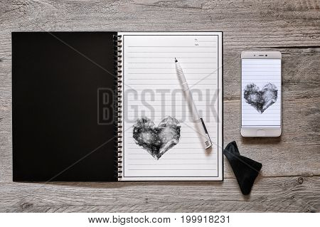 Top view of stone paper reusable wipeable rewritable notebook with pen and wipe cloth digitizing creativity concept