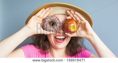 Beauty girl taking colorful donuts. Funny joyful woman with sweets, dessert. Diet, dieting concept. Junk food, Celebration and party