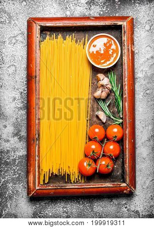 Pasta Background. Spaghetti With Sauce And Tomatoes In The Old Tray.