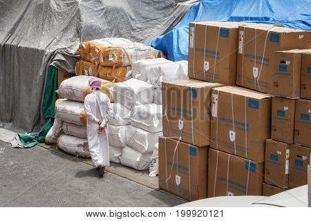 Dubai, United Arab Emirates - May 01, 2017: An Unidentified Man Wearing Traditional Arab Outfit Walk