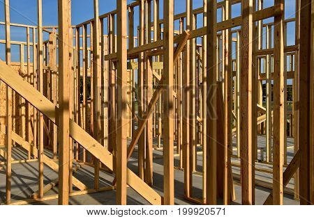 A building resting on a concrete pad with no basement is in the process of being framed