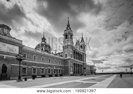Madrid Spain - May 22 2014: Wide-angle view of the Cathedral of Saint Mary the Royal of La Almudena in cloudy weathe. Madrid is a popular tourist destination of Europe. Black and white retro style.