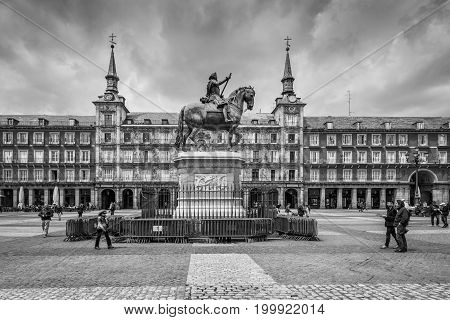 Madrid Spain - May 22 2014: Plaza Mayor with statue of King Philips III in Madrid Spain. Black and white retro style. Architecture and landmark of Madrid.