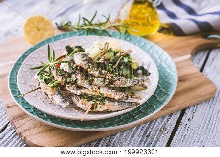 Healthy sardines with potato and chard .