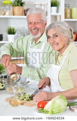Portrait of a happy senior couple preparing dinner together