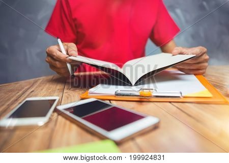 Man Hand Writting, Business Man Working Hard Seriously Work At Home Concept, He Is Wearing Red Shirt