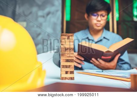 A Student Of Structural Engineer Reading A Book Of University.