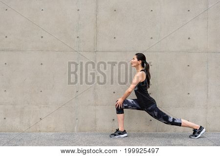 Full Length Of Pretty Sporty Young Woman Warm Up