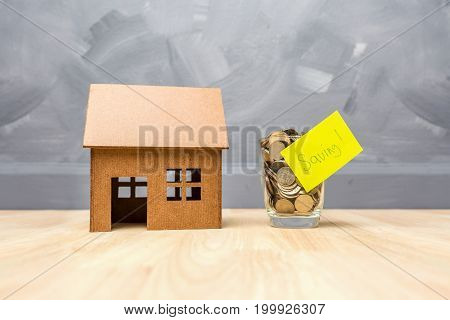 Saving Money In The Glasses Bottle For Buy A House Real Estate Concept, Or Build A New Home With Tha