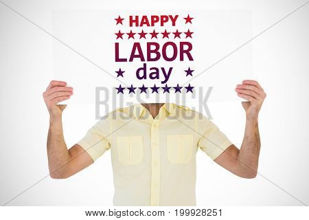 Man holding card in front of his face against poster of happy labor day text