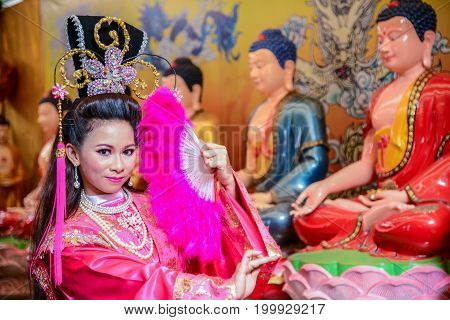 Chachoengsao Thailand - July 14 2013 : Beautiful woman with traditional chinese pink dress in Chinese shrine in Thailand.