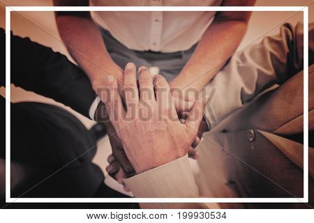 High angle view of business people gathering their hands together