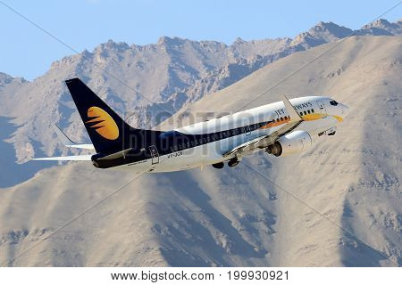 Leh, India 11 September 2016 - Jet Airways aircraft flies out of Leh Airport which is located at 11000 ft above mean sea level. The approach is challenging as it is unidirectional and has high terrain